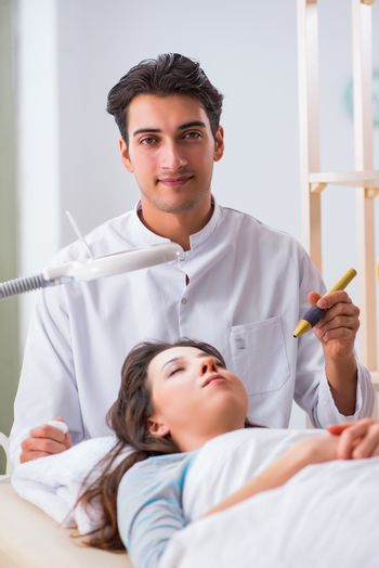 Woman visiting dermatologyst for laser scar removal