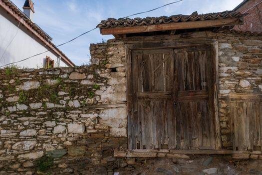 beautiful old wooden door locked in a distant village