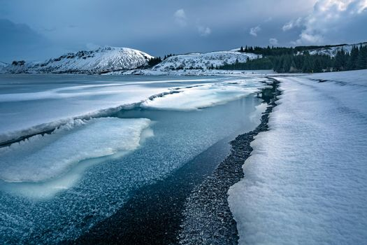 Beautiful View on the Mountains and Sea Covered with Snow. Travel among Ices of Antarctica. Snowy Landscape of Iceland.