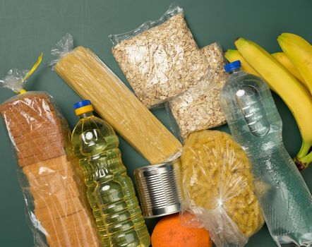 various products, fruits, pasta, sunflower oil in a plastic bottle and preservation