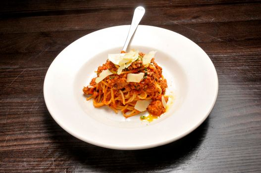Heaping bowl full of delicious spaghetti and sauce