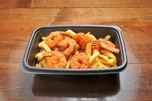 Delicious fried seafood best known as shrimp and french fries