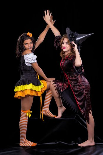 The doll and the witch in halloween