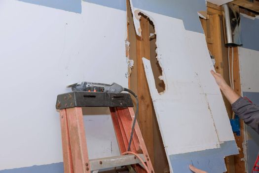Demolished old plasterboard wall with interior kitchen renovation in progress