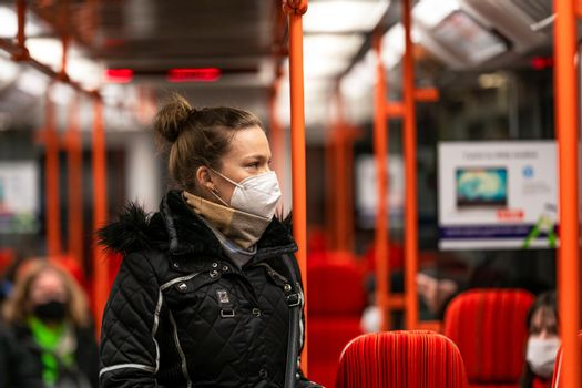The woman travels by public transport around the city