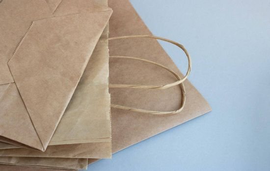 Eco-friendly packages on a gray background. The concept of a sustainable, environmentally friendly lifestyle.