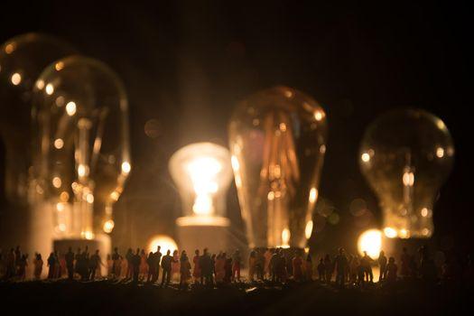 Beautiful retro luxury interior bulb lighting lamp decor glowing in dark. Crowd looking on bulbs. Selective focus