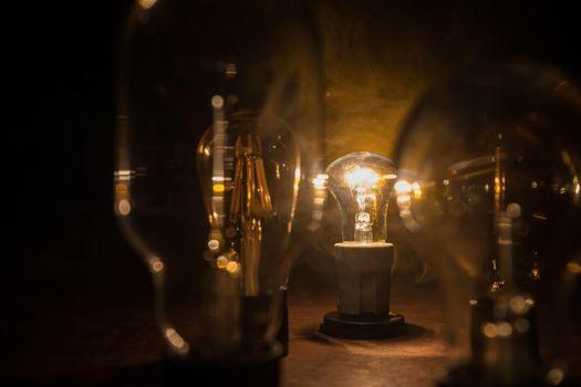 A lot of bulbs. Beautiful retro luxury interior bulb lighting lamp decor glowing in dark. Selective focus