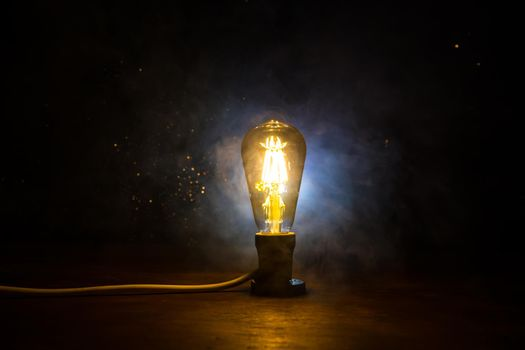 Beautiful retro luxury interior bulb lighting lamp decor glowing in dark. Selective focus