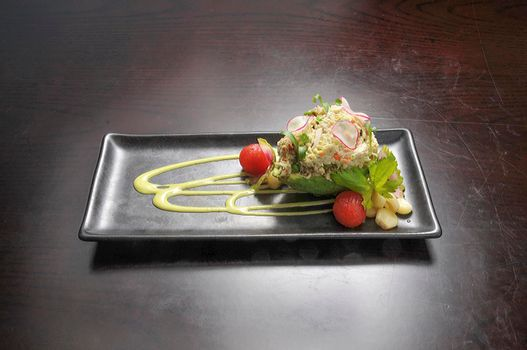 Delicious Mexican dish known as crab stuffed avocado