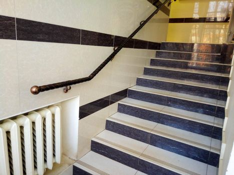 Stairs, railings and steps in a modern building.