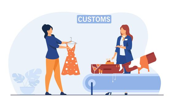 Customs employee checking luggage of tourist
