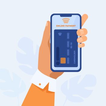 Hand holding smartphone and paying online