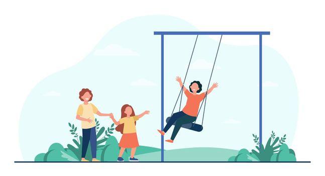 Happy kid swinging on swing