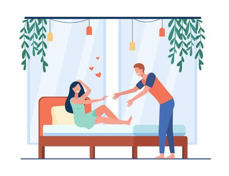 Happy young couple flirting at bedroom