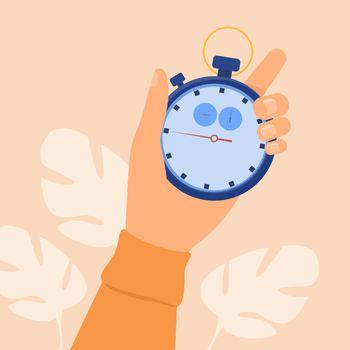 Human hand holding stopwatch