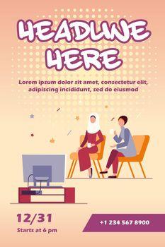 Muslim women sitting and watching TV