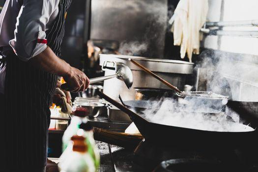 Chef stir fry in wok