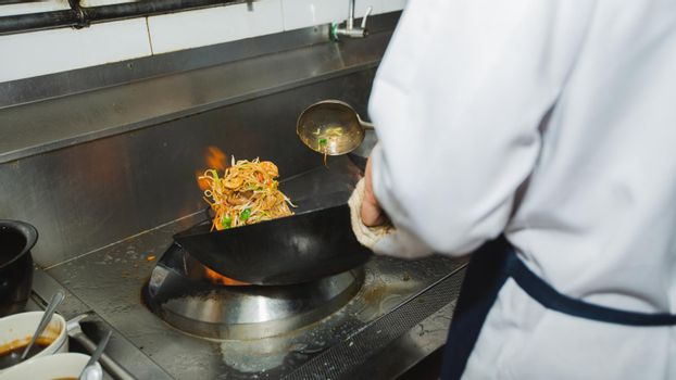 Chef stir fry cooking