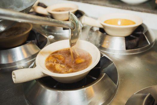 Boiling shark's fin soup