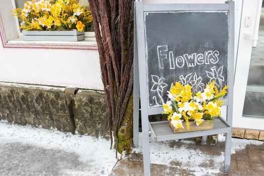 A street billboard outside a flower shop.Advertising of flowers.