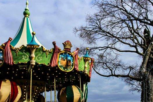 Colorful Merry-go-round in a park in Lisbon at Christmas