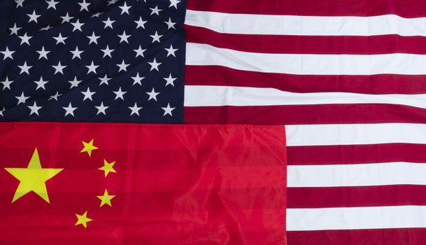 Waving US and Chinese flags for the Trade War Concept