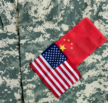 USA and China flags on military uniform background for trade war concept