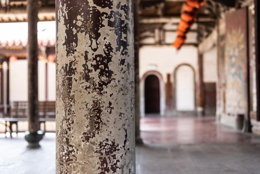 aged wooden pillar with crack paint