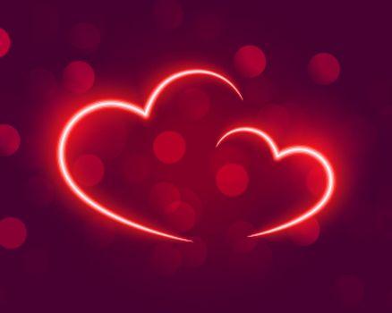 neon glowing hearts on bokeh background