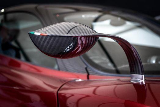 LONDON, UK - CIRCA JUNE 2014: Carbon fibre Pagani Huayra wing mirror with Italian flag.