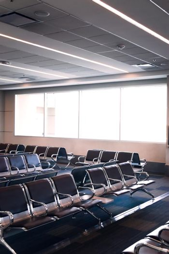 Empty seats at the waiting area of an airport.