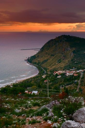 Elevated view of the coast near Terracina, Italy, at sunset.