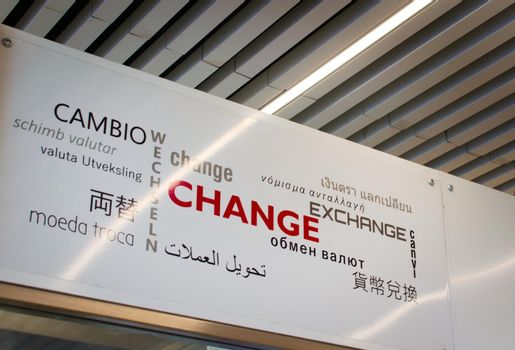 Currency exchange sign at an airport.