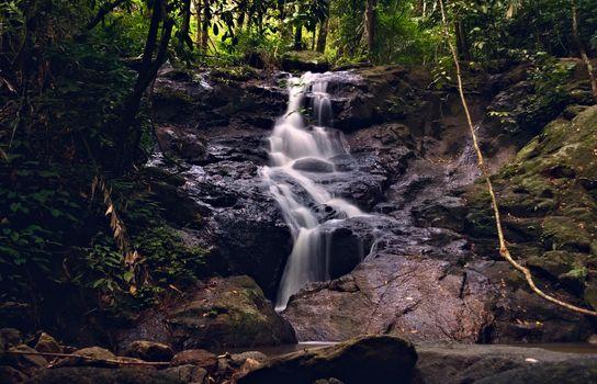 Kathu waterfall in Phuket, Thailand. Beautiful cascade in the jungle.