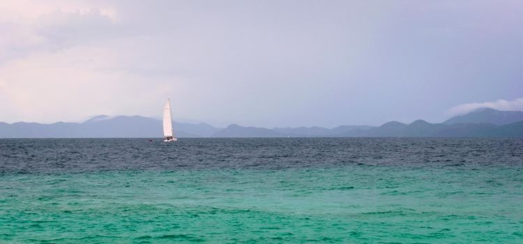 Sailboat on the turquoise waters of Andaman Sea, near Phuket, Thailand.