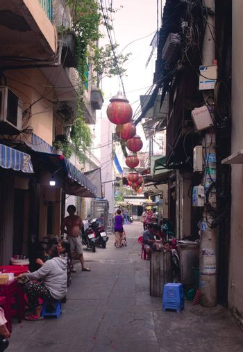 2019-11-10 / Ho Chi Minh City, Vietnam - Everyday life scene. Narrow back alley in a poor area of the city.