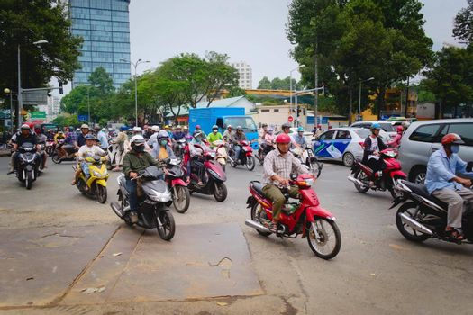 2019-11-10 / Ho Chi Minh City, Vietnam - Urban scene in rush hour. Motorcycles flood the chaotic traffic flow of the city.
