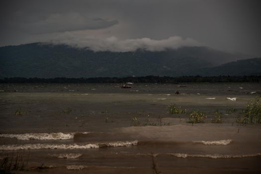 The beauty of Bang Phra Reservoir on the background of misty capped mountains, Chonburi Province.