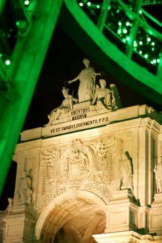 Rua Augusta Arch illuminated at night in Lisbon