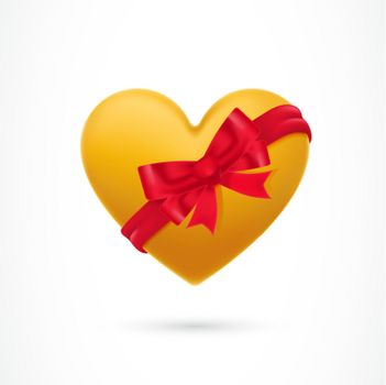 Yellow heart covered with ribbon