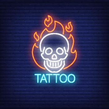 Tattoo neon word with smiling skull in flame outline
