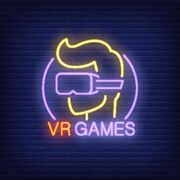 VR Games lettering and player in glasses neon sign