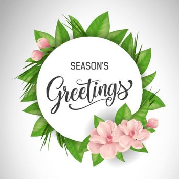 Seasons greetings lettering in circle with pink flowers
