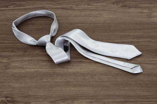 Silver color necktie on table