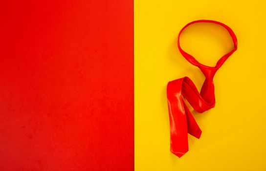 red necktie on color background
