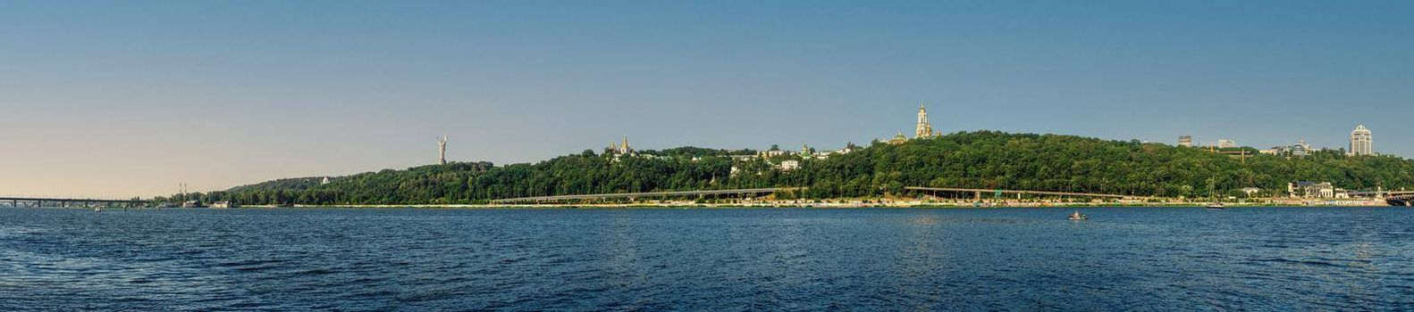 Kyiv, Ukraine 07.11.2020. View of the left bank and the Dnieper river in Kyiv, Ukraine, on a sunny summer morning
