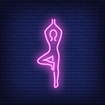 Person doing yoga neon sign