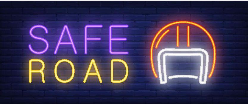 Safe road neon text with helmet