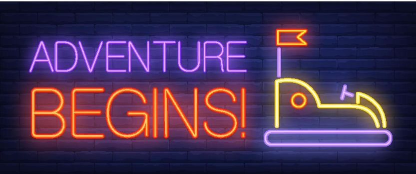 Adventure begins neon text with bumper car